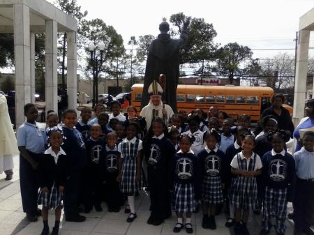 St. Rita Students Pictured  with Archbishop of New Orleans, Fr.Gregory Aymond